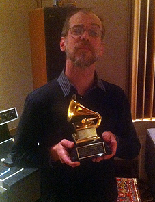 Louis Butelli with one of Charlie Pilzer's Grammy Awards