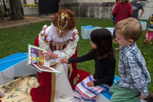 The Queen reads to children at Shakespeare's birthday. (Chester Simpson)