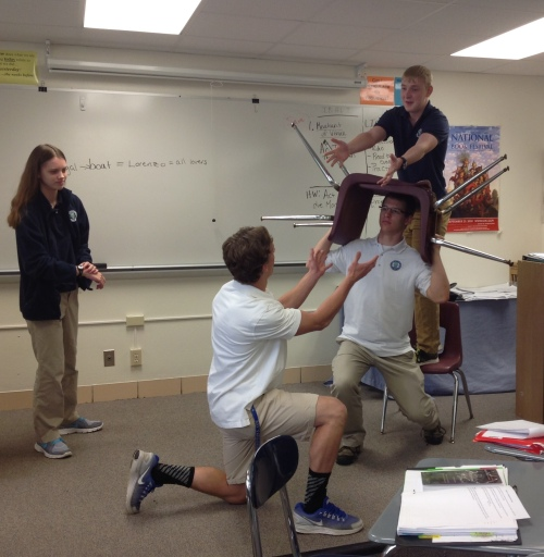 Students close read on their feet in Stefanie's English class.  (Image: Stefanie Jochman)